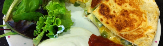 Quesadillas with salad, salsa and sour cream