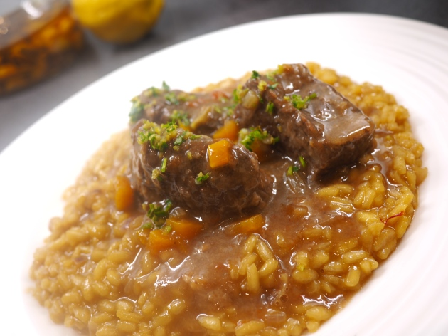 Osso Buco from the side on saffron risotto